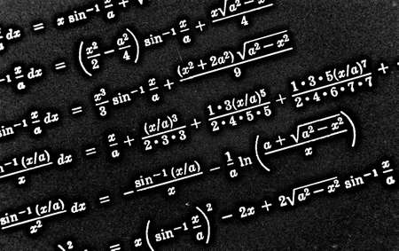 Large number of mathematical formulas on a black background HDR