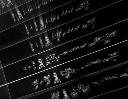 Large number of mathematical formulas focus zoom on a black background Stock Photo