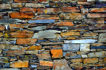 Close-up detail view of an old traditional stone wall built from schist in Piod�o, made of shale rocks stack, one of Portugal's schist villages in the Aldeias do Xisto. Stock Photo - 115006545