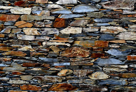 Close-up detail view of an old traditional stone wall built from schist in Piod�o, made of shale rocks stack, one of Portugal's schist villages in the Aldeias do Xisto. Stock Photo - 114996843
