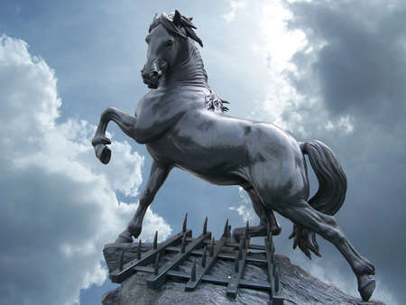 metal sculpture: horse statue on the sky with clouds