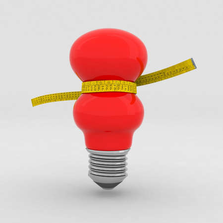 red bulb on a diet with tape measure photo