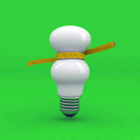 light bulb on a diet with tape measure Stock Photo - 9411327