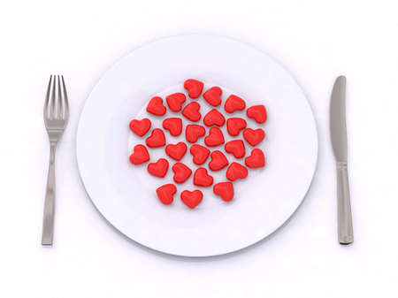 many hearts on the plate with knife and fork photo