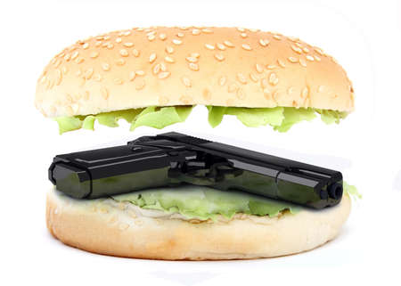 sandwich inside gun, dangerous food concept photo
