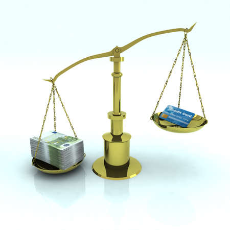 credit card and euro bank notes on golden balance scale  photo