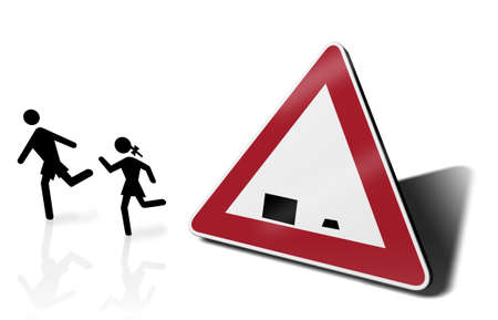 child holding sign: traffic sign school with children symbol outside Stock Photo