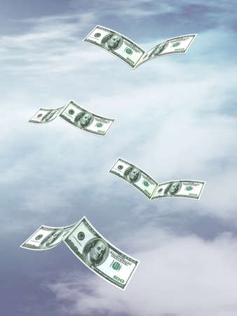 U.S. dollar banknotes that fly like birds, on sky background photo