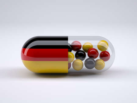 Pill with German flag wrapped around it and red ball inside, 3d illustration