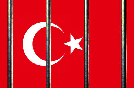 convicted: Turkish flag behind Jail Bars, 3d illustration Stock Photo