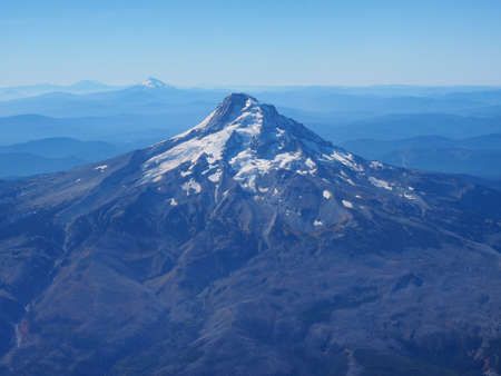 Mount Hood photographed from the window seat of an airplane on final approach to Portland, Oregon.