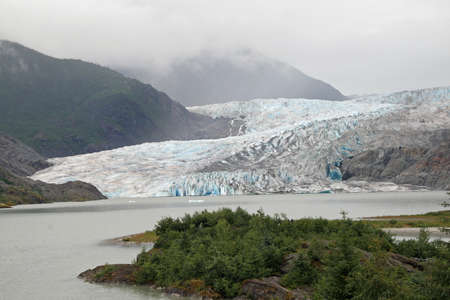 Mendenhall Glacier and Valley, Alaska, photographed from the Visitor Center on an overcast summer day. 写真素材