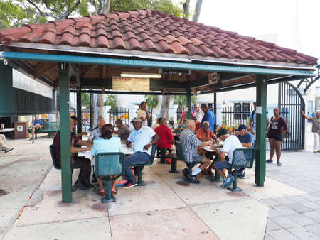 Miami, Florida 10-21-2018 Senior Cubans gather at Domino Park on Calle Ocho - Eigth Street - in Little Havana for a game of dominoes. Editoriali