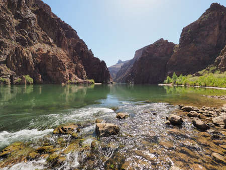A placid stretch of the Colorado River just above Granite Rapids in Grand Canyon National Park, Arizona. Stock Photo
