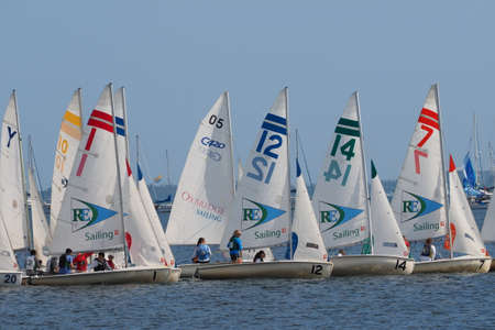 Miami, Florida 01-09-2015 Sailboats in a high school regatta in Biscayne Bay on a sunny winter day.