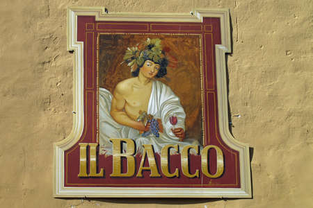 Barolo, Italy 04-10-2011 Il Bacco - Bacchus - restaurant sign in the town of Barolo in the Piemonte wine region of northern Italy.