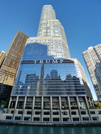 Chicago, Illinois 10-08-2016 Trump Tower on the Chicago River on a clear fall morning. Editorial