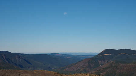 Moon setting over ridges to the west of Mount Saint Helens as seen from the Johnston Rodge Observatory, Washington.