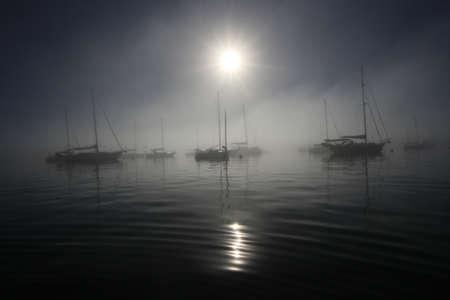 Bright fogbow over the sailboats anchored off Crandon Marina in Key Biscayne, Florida, on a calm, foggy morning. Archivio Fotografico