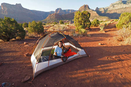 Backpacking couple in their tent in early morning on Horseshoe Mesa in Grand Canyon National Park, Arizona.