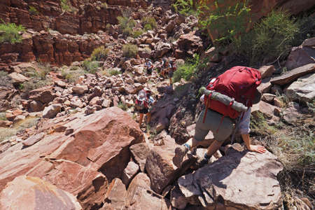 Backpackers descending the Tonto Trail in Mineral Canyon in Grand Canyon National Park, Arizona on a clear May morning.
