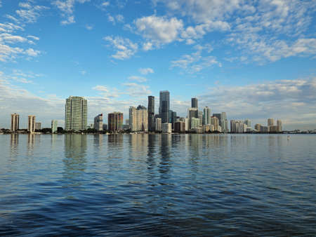 Miami, Florida 11-24-2018 The skyline of the City of Miami, Florida, reflected in the calm water of Biscayne Bay in early morning light.