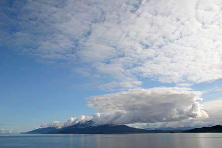 Alaskas Inside Passage on a calm and sunny summer afternoon. Stock Photo