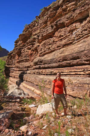 Young woman backpacker explores Hance Creek in Grand Canyon National Park, Arizona.