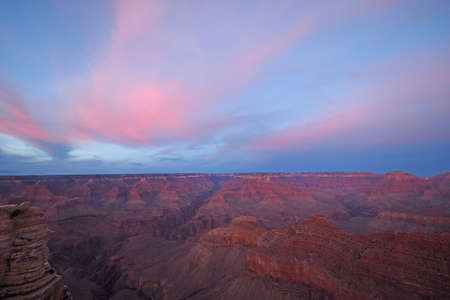 Pink clouds over the south rim of the Grand Canyon at sunset from Mather Point in Grand Canyon National Park, Arizona.