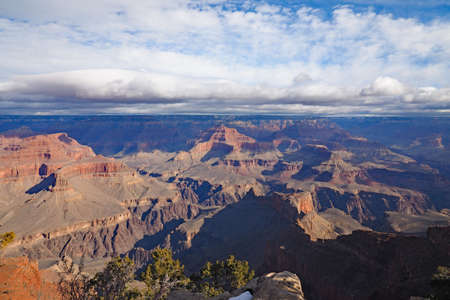 View of the Grand Canyon under a complex cloudscape from the South Rim Trail in Grand Canyon National Park, Arizona, in winter.
