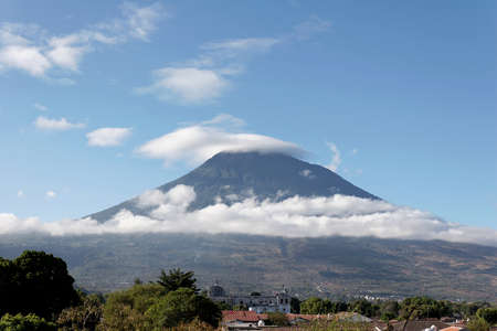 The Agua Volcano, a prominent stratovolcano visible throughout the city of Antigua in southern Guatemala.