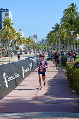 Miami Beach, Florida 2019-04-14 Young female triathlete at the start of the running segment of the 2019 South Beach Triathlon.