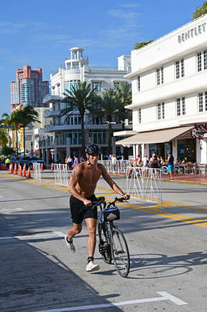 Miami Beach, Florida 2019-04-14 Triathletes completing the bicycling segment of the 2019 South Beach Triathlon with art deco buildings in background.