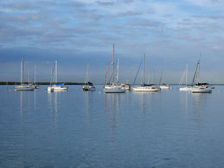 Sailboats anchored off Crandon Marina in Key Biscayne, Florida, on a calm February morning.