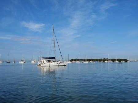 Sailboats anchored off Crandon Marina in Key Biscayne, Florida, on a calm February morning.