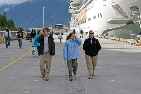 Skagway, Alaska - August 2, 2006 - Cruise passengers walk on the dock in Skagway on a shore excursion during an Inside Passage cruise.