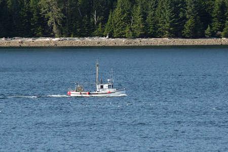 Inside Passage, Alaska - August 5, 2006 - Workboat cruises waters of Inside Passage on sunny summer day. 新聞圖片