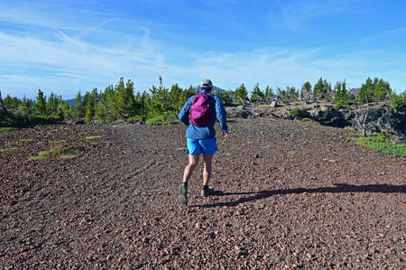 Young male trail runner begins descent of Tam McArthur Rim Trail in Three Sisters Wilderness near Sisters, Oregon. Reklamní fotografie