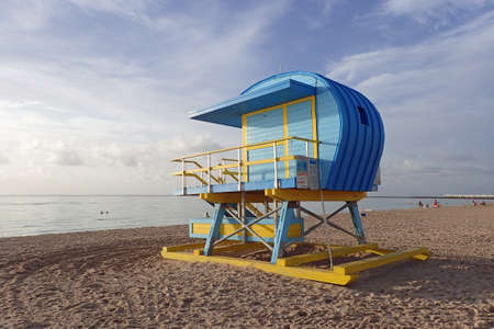 Colorful lifeguard station on South Beach in Miami Beach, Florida at sunrise.
