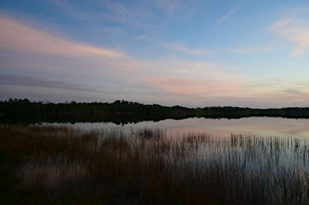 Sunrise cloudscape reflected on calm water of Nine Mile Pond in Everglades National Park, Florida. Stock Photo