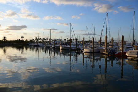 Key Biscayne, Florida - November 30, 2019: Yachts docked in Crandon Marina at sunrise on a crisp winter morning.