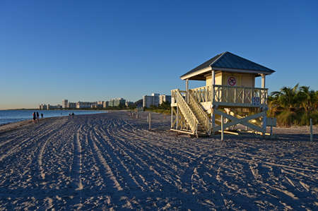 Lifeguard station on Crandon Park Beach in Key Biscayne, Florida at sunrise on clear cloudless winter day.