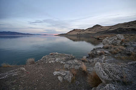 Rock formations and reflections of Pyramid Lake, Nevada on clear tranquil winter afternoon. Stock Photo