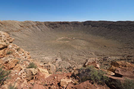 Meteor Crater near Winslow, Arizona on clear cloudless summer afternoon.