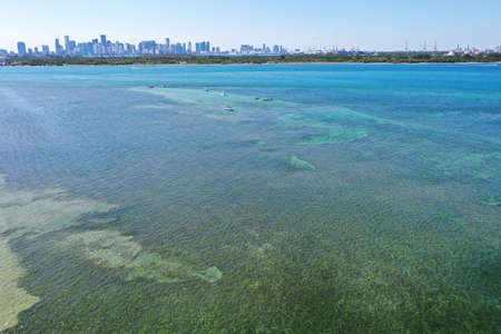 Aerial view of Bear Cut in Key Biscayne, Florida on a sunny May afternoon at low tide.