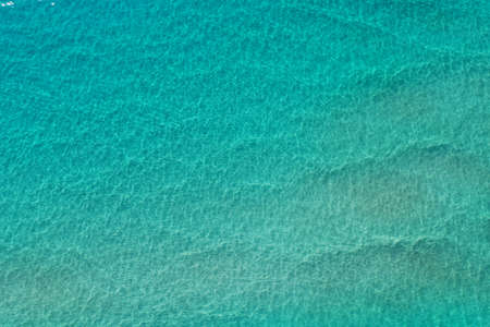 Aerial view of clear shallow water on sand bar off Miami Beach, Florida on bright sunny summer morning.
