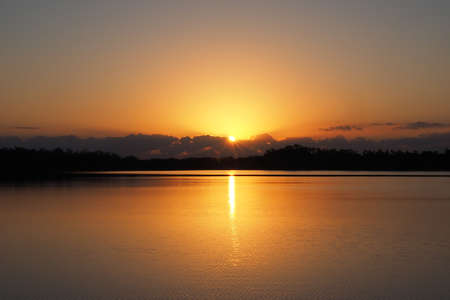 Sunrise over tranquil water of Nine Mile Pond in Everglades National Park, Florida on calm clear morning. 版權商用圖片