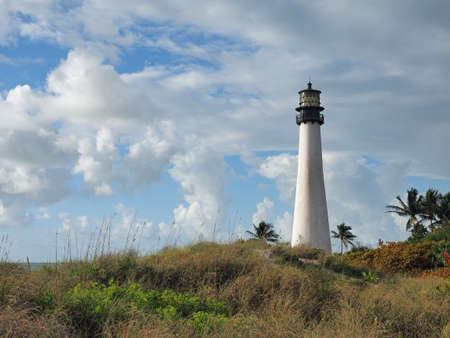 Cape Florida Lighthouse in Bill Baggs Cape Florida State Park on Key Biscayne, Florida on bright cloudy morning.