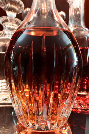Closeup of decanters on silver tray containing variety of liquors with limited depth of field. 版權商用圖片