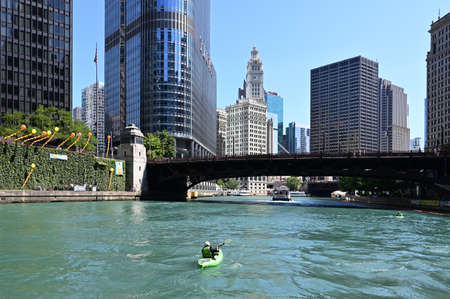 Chicago, Illinois - August 8, 2019 - View of Chicago River, its bridges and surrounding buildings on a clear sunny summer day.